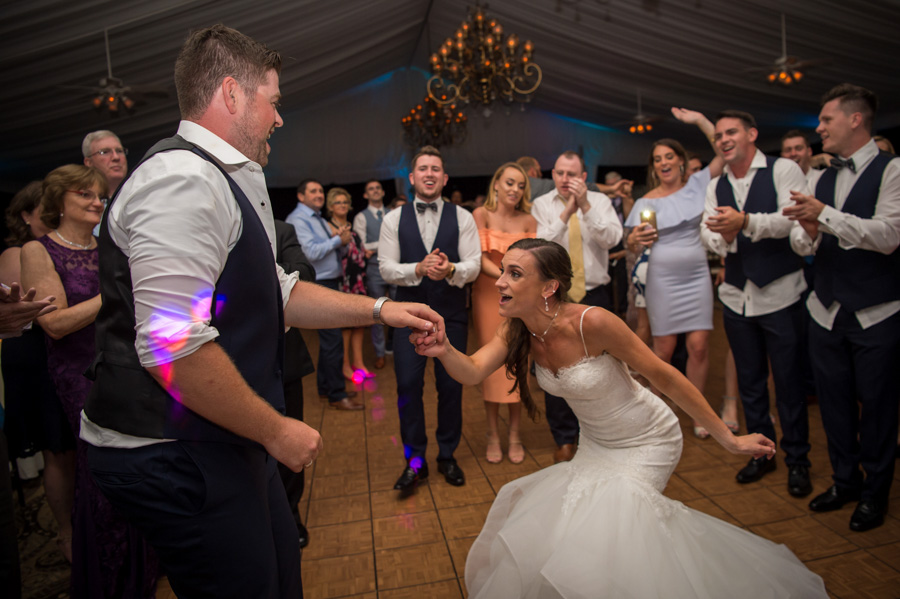 Wedding couple and party on the dance floor dancing to music provided by MSV Entertainment.